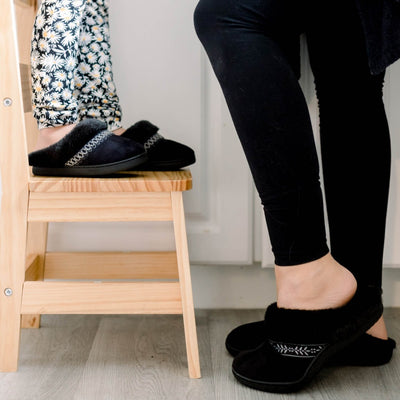 Isotoner Kids Wendi Slipper standing on stool with mom in kitchen wearing matching slippers