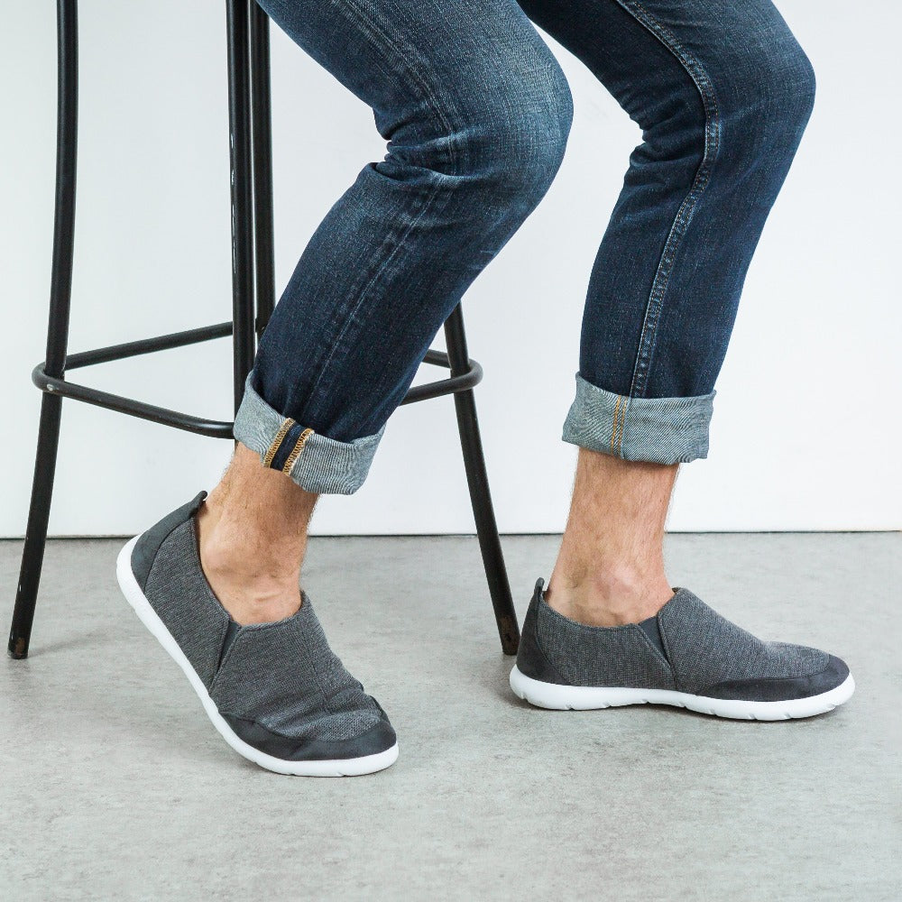 Zenz Men's Activate Slip-On in Mineral on model sitting on a stool