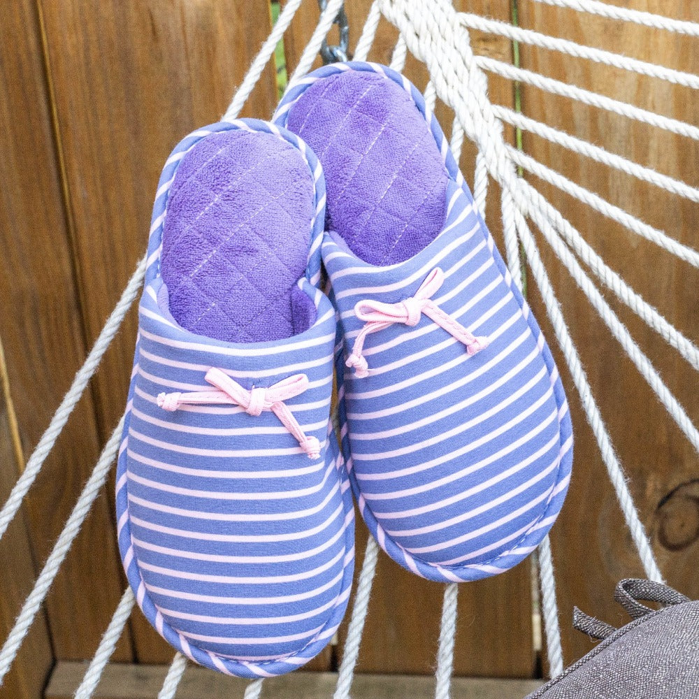 Women's Nani Stripe Clog Slippers in Iris sitting on the ropes of a hammock