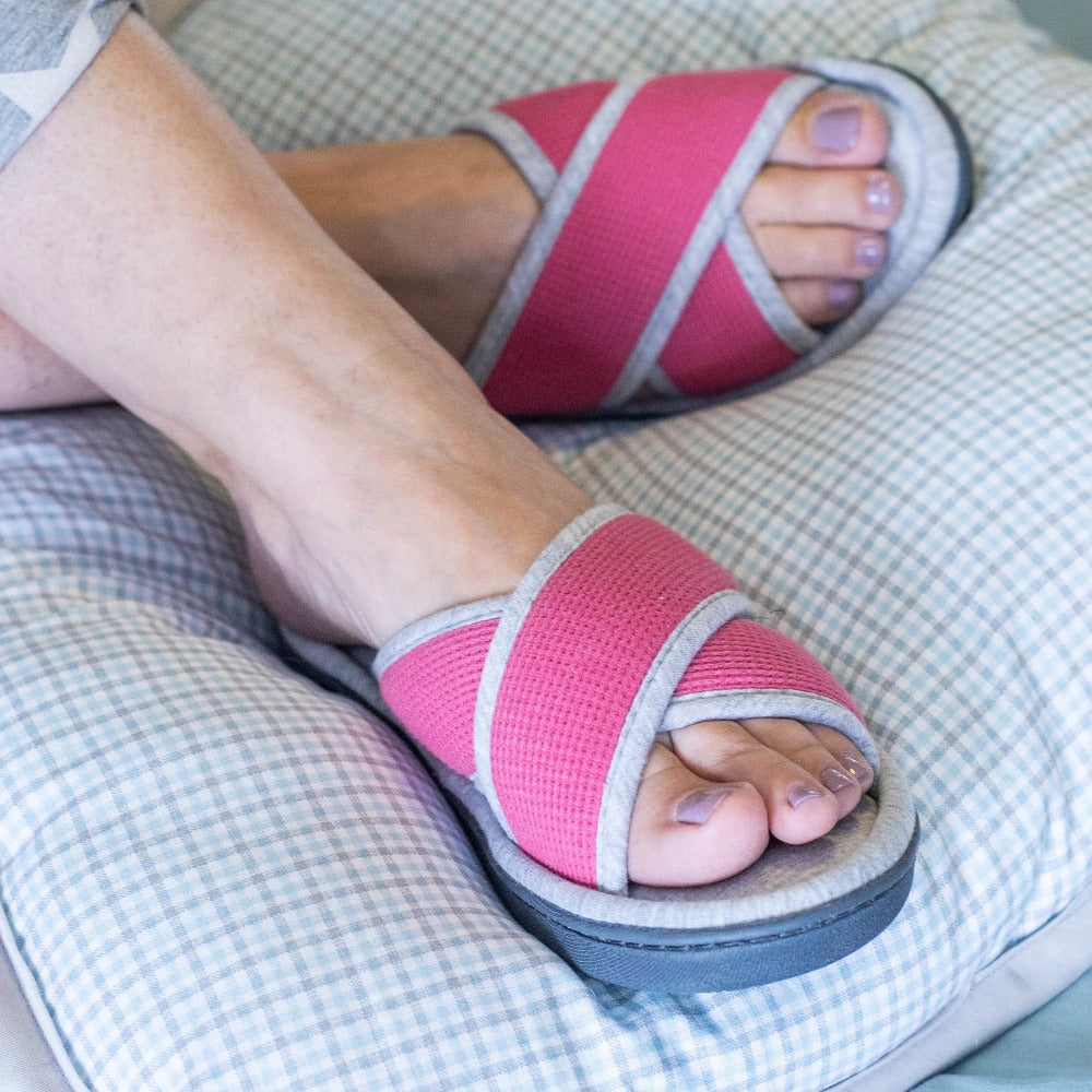 Women's Waffle Knit Helena X-Slide Slipper in Strawberry on figure with the model's feet on up a grey plaid pillow