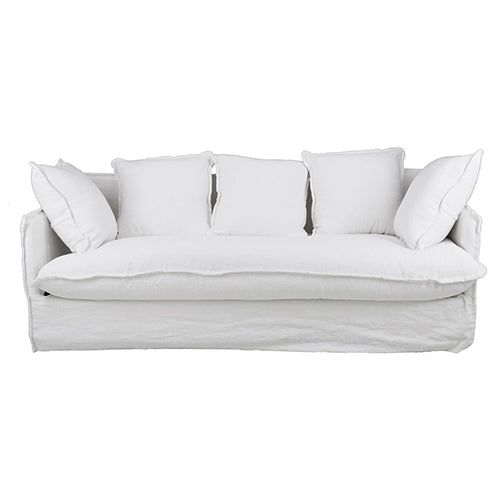 White linen slipcover sofa. The Boholuxe Home