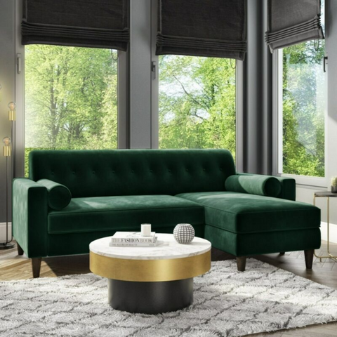Dark Green Velvet Corner Sofa with Bolster Cushions.