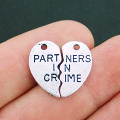 2 Partners in Crime Antique Silver Tone Charms - SC1296