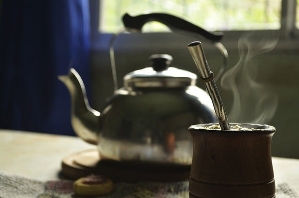 A kettle and a gourd of yerba mate