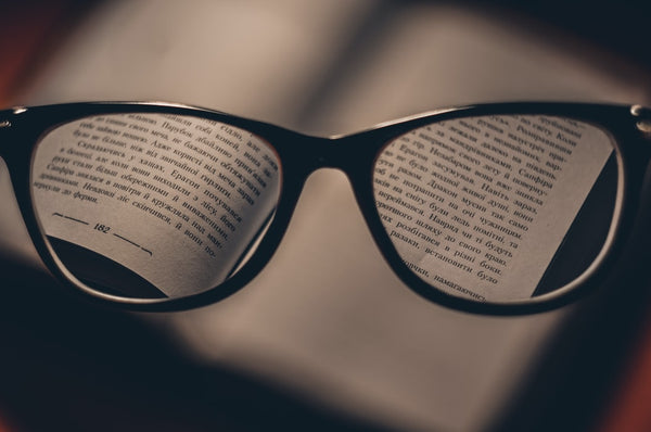 glasses focused on a book