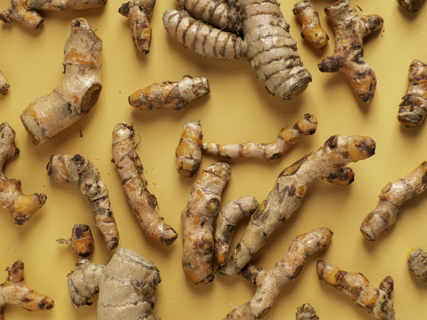 Several pieces of turmeric root.