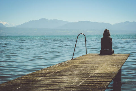 Woman sitting on the dock