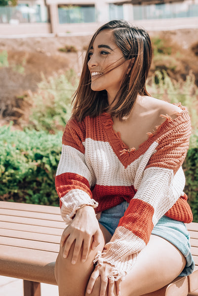 girl sweater smiling in wind