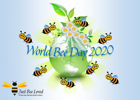 World Bee Day 2020 image featuring bees flying around the globe by Just Bee Loved