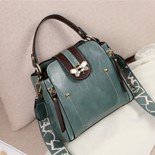 Load image into Gallery viewer, Flap over bumblebee two-toned vegan friendly leather handbag in sage green colour.
