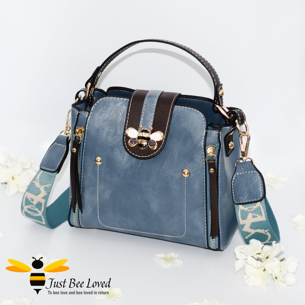 Flap over bumblebee two-toned vegan friendly leather handbag in sky blue colour.