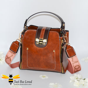 Flap over bumblebee two-toned vegan friendly leather handbags in brown.