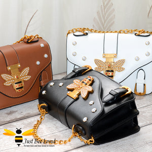 Just Bee Loved Satchel Style PU Leather Handbags featuring large bee buckle embellished with rhinestones and pearl studs in colours black, cream and brown