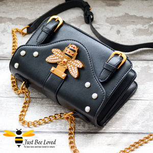Just Bee Loved Satchel Style PU Leather Handbags featuring large bee buckle embellished with rhinestones and pearl studs in colour black