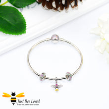 Load image into Gallery viewer, Sterling Silver 925 Bangle with two rose crystal charms and sterling silver bee charm