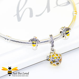 Sterling Silver 925 snake charm bracelet with two enamelled bee charms and honeycomb crystal ball pendant