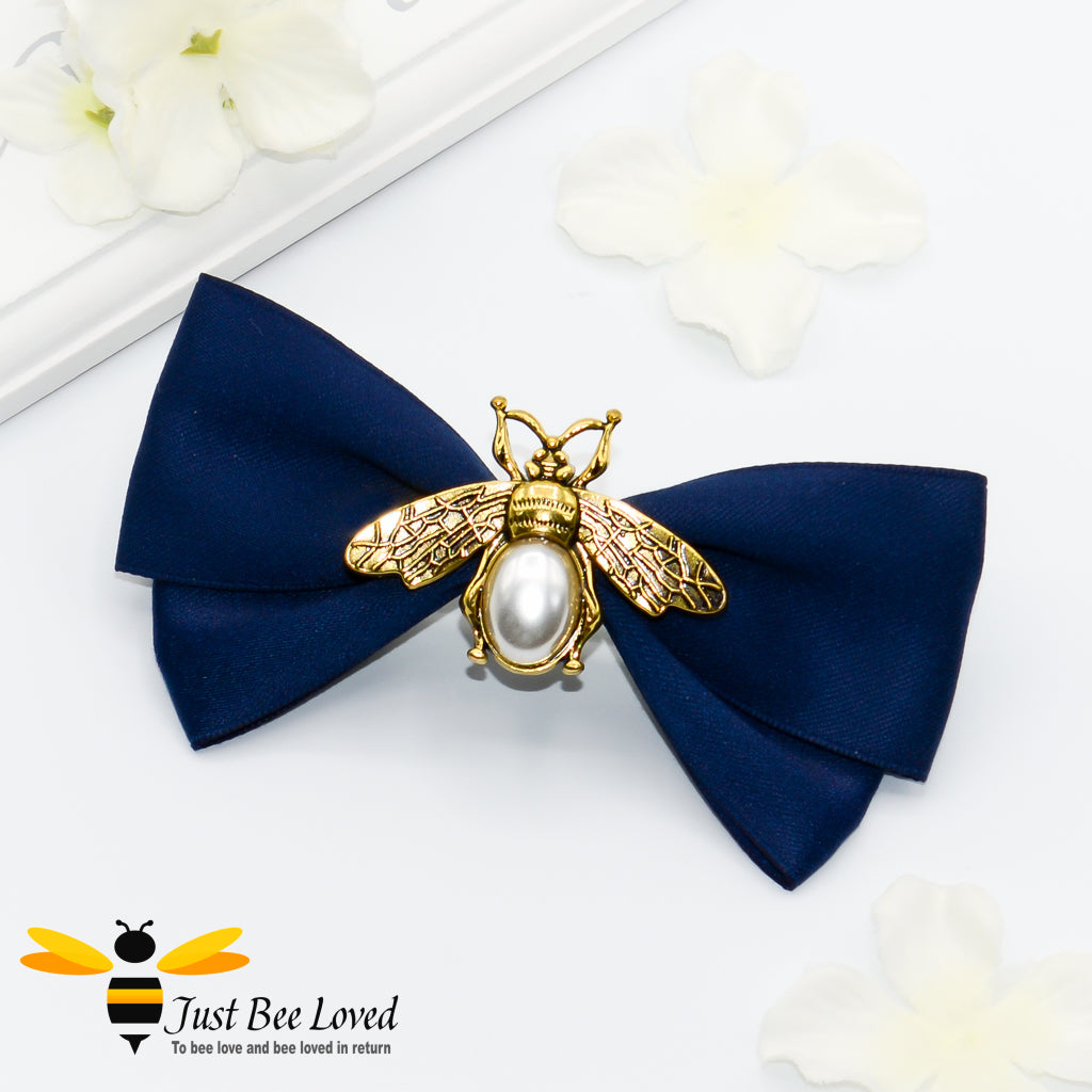 Handmade vintage hair bow clip with gold and pearl bees in navy, green and pink