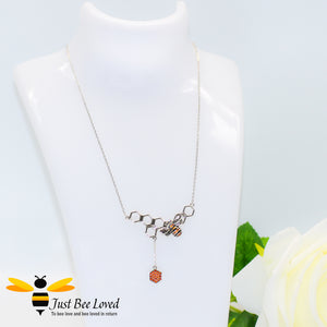 Sterling Silver 925 Necklace with sterling silver bee pendant encrusted with black and orange cubic zirconia on a honeycomb with honeycomb dangle