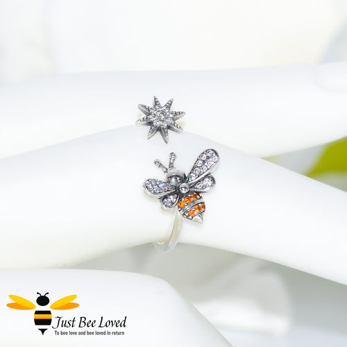 Sterling silver 925 open ring featuring a bee and star with white and orange zirconia
