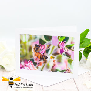 Honey bee foraging in a field of wild flowers Photographic Blank Greeting Card image by Landscape & Nature Photographer Yasmin Flemming