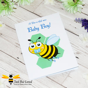 Just Bee Loved Little Bee New Baby Boy Greeting Card featuring a cute baby bumble bee with a dummy design by Artist Yasmin Flemming