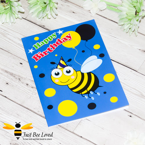 Just Bee Loved Little Bee Happy Birthday Greeting card for boy featuring bumble bee with a party hat and balloons design by Artist Yasmin Flemming