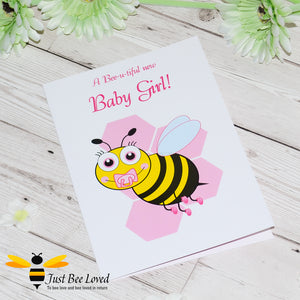 Just Bee Loved Little Bee New Baby Girl Greeting Card featuring a cute baby bumble bee with a dummy design by Artist Yasmin Flemming