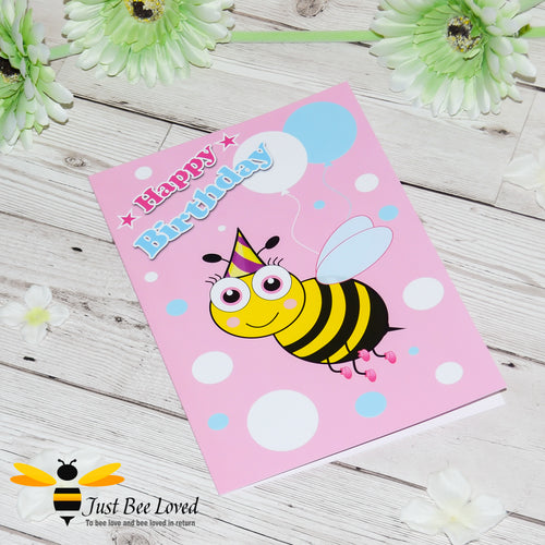 Just Bee Loved Little Bee Happy Birthday Greeting card for Girl featuring bumble bee wearing a party hat and balloons design by Artist Yasmin Flemming