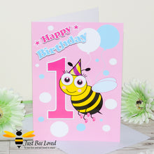 Load image into Gallery viewer, Just Bee Loved Little Bee Happy 1st Birthday for girl greeting card featuring a cute bumble bee with a party hat with the number 1 and balloons design by Artist Yasmin Flemming