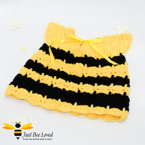 Hand crocheted smocked styled baby girl bee dress.
