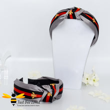 Load image into Gallery viewer, Ladies Knot twist headband with embroidered bees in five colours