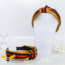 Load image into Gallery viewer, Ladies Knot twist headband with embroidered bees in mustard colour with red and black stripe