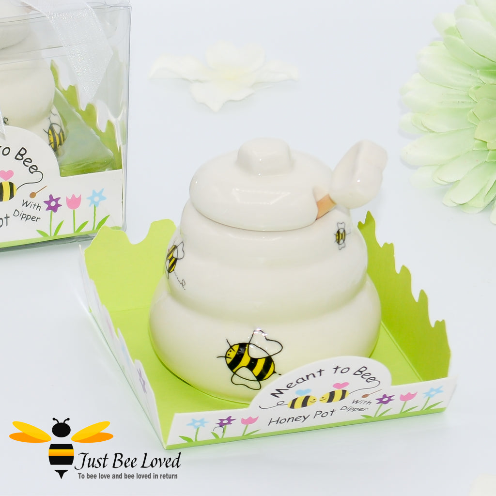 Ceramic cute hive honey pot with dipper, decorated with bees in a gift box with