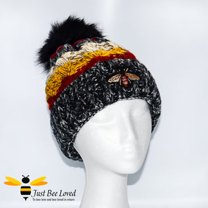 Ladies thick knitted black wool hat with large bumblebee embroidery