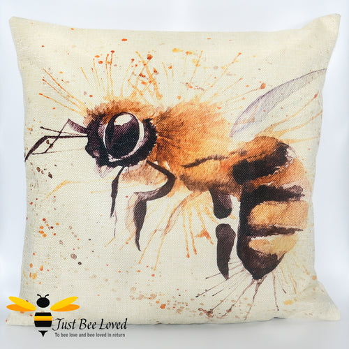Scatter cushion featuring a watercolour image of a honey bee against splash background