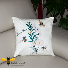 "Load image into Gallery viewer, Soft and luxurious to the touch, large scatter cushion featuring embroidered design image of bumblebees and flowers with ""Love You"" text."