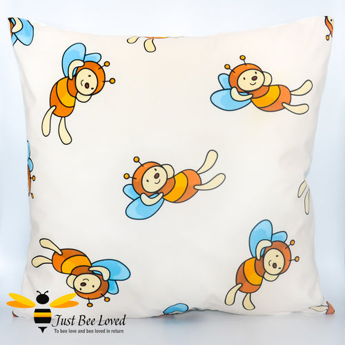 Children's decorative bee scatter cushion in cream featuring cartoon bumblebees