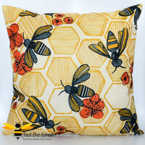 Scatter cushion featuring honey bees and poppies with a honeycomb background