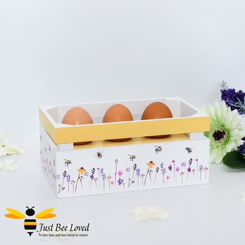 Egg crate from the Jennifer Rose Busy Bees range; featuring a watercolour design of flying bumblebees in a field of flowers.