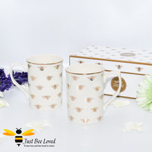 Load image into Gallery viewer, Part of the Leonardo Queen Bee range, sleek ivory fine China tea/coffee set of two mugs bee-utifully decorated with golden bees and gold rim.