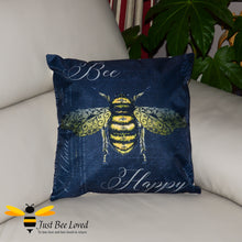 "Load image into Gallery viewer, Large scatter cushion featuring a classic design of a golden bee amongst beautiful calligraphy and the joyful message ""Bee Happy"" in dark navy colour."