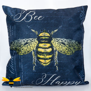 "Large scatter cushion featuring a classic design of a golden bee amongst beautiful calligraphy and the joyful message ""Bee Happy"" in dark navy colour."