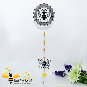 hanging silver wind spinner featuring the design of two bees with honey coloured crystals and oval chandelier crystal.