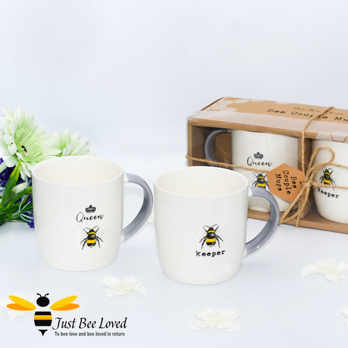 Bee design couple mugs gift set.  Featuring two matching mugs with one saying 'Bee keeper' and the other 'Queen bee'.  In white colour with grey handles. Gift box presented