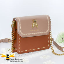 Load image into Gallery viewer, two-tone brown PU with large vintage gold bee embellishment, contrasting cream stitching, gold side studs with matching strap of part leather and gold chain.