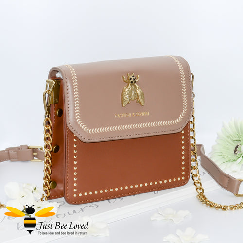 two-tone brown PU with large vintage gold bee embellishment, contrasting cream stitching, gold side studs with matching strap of part leather and gold chain.