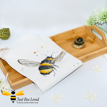 Load image into Gallery viewer, bamboo serving tray hand-painted by British artist Joanna Williams; featuring a painting of a bumblebee, with matching bee print cream cotton tea towel