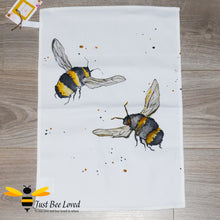 Load image into Gallery viewer, luxurious cream coloured cotton tea-towel featuring bumblebees in flight art work by British artist Joanna Williams.