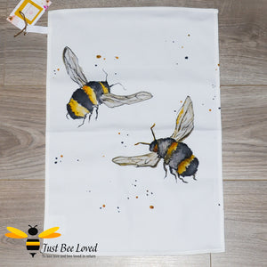 luxurious cream coloured cotton tea-towel featuring bumblebees in flight art work by British artist Joanna Williams.