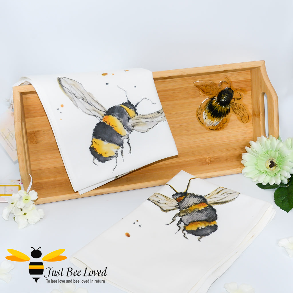 bamboo serving tray hand-painted by British artist Joanna Williams; featuring a painting of a bumblebee, with matching bee print cream cotton tea towel